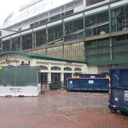 Gate D area, Billy is fenced in, but nothing seems about to happen to the Draft Kings building