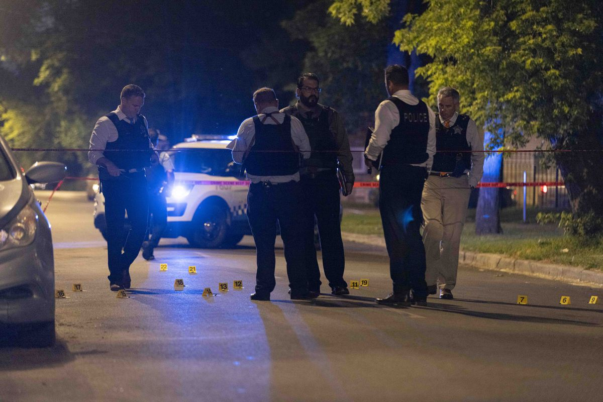 Police investigate the scene where a 9-year-old boy was grazed by a bullet to the head at 54th and Morgan streets in Back of the Yards, Tuesday, June 8, 2021.