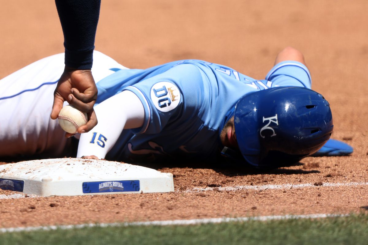 Whit Merrifield #15 of the Kansas City Royals dives back toward first base during the 1st inning of the game against the Minnesota Twins at Kauffman Stadium on August 23, 2020 in Kansas City, Missouri.
