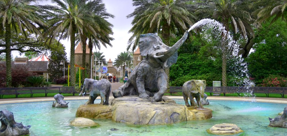 A water fountain with several large sculptures of elephants.