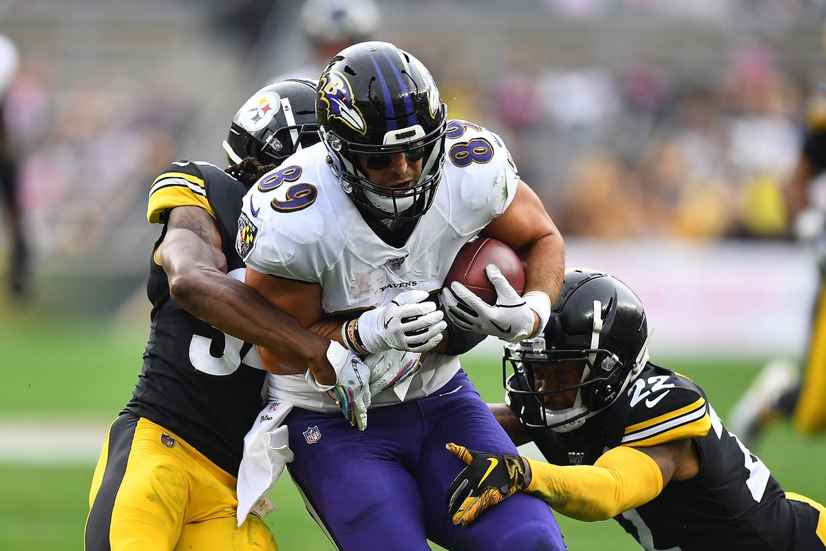 Mark Andrews of the Baltimore Ravens gets wrapped up by Terrell Edmunds and Steven Nelson of the Pittsburgh Steelers during the first half at Heinz Field on October 6, 2019 in Pittsburgh, Pennsylvania.