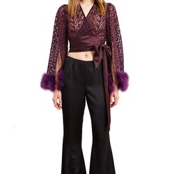 A butterfly embroidered top from Sui's spring 1993 collection worn with satin flare pants from her '94 one.