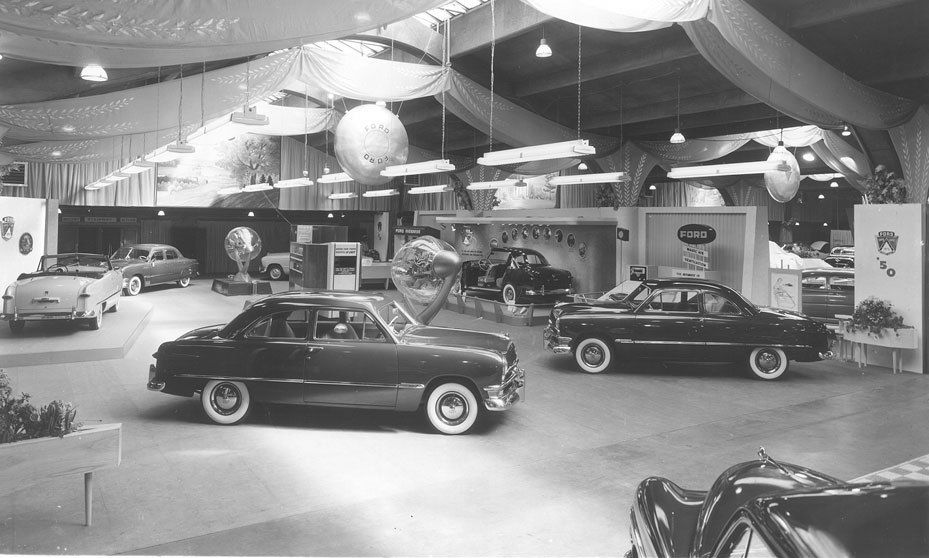 The Ford exhibit at the 1950 Chicago Auto Show, featuring several body styles, and a cutaway model near the center of the image.   Chicago Auto Show archives.