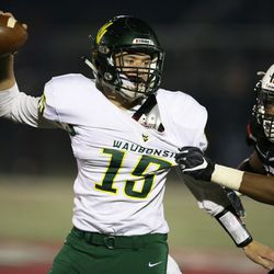 Waubonsie Valley's Jack Drow (15) looks to complete a pass. Allen Cunningham/For the Sun-Times.