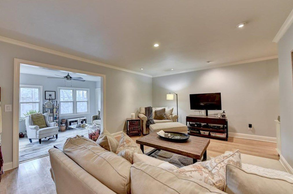 A large white living room space with a white couch.