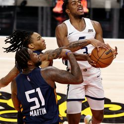 Utah Jazz White team forward Trent Forrest (3) is fouled by Utah Jazz Blue team guard Kyle Allman (43) in the air as he goes to the basket as the Utah Jazz Blue and White teams play in summer league action at Vivint Smart Home Arena in Salt Lake City on Friday, Aug. 6, 2021.