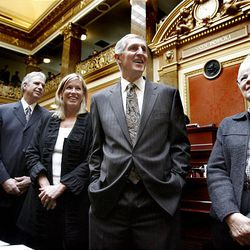 Former Utah Jazz coach Jerry Sloan and his wife, Tammy, are flanked by Phil Johnson and Gail Miller as they were honored on the House floor.