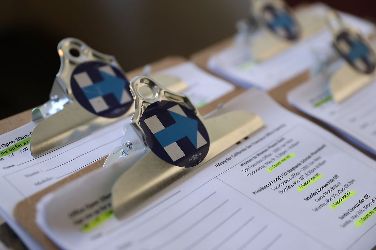 Clipboards with volunteer sign up sheets are displayed during the grand opening of a Hillary Clinton for California organizing office on May 9, 2016, in San Francisco, California.