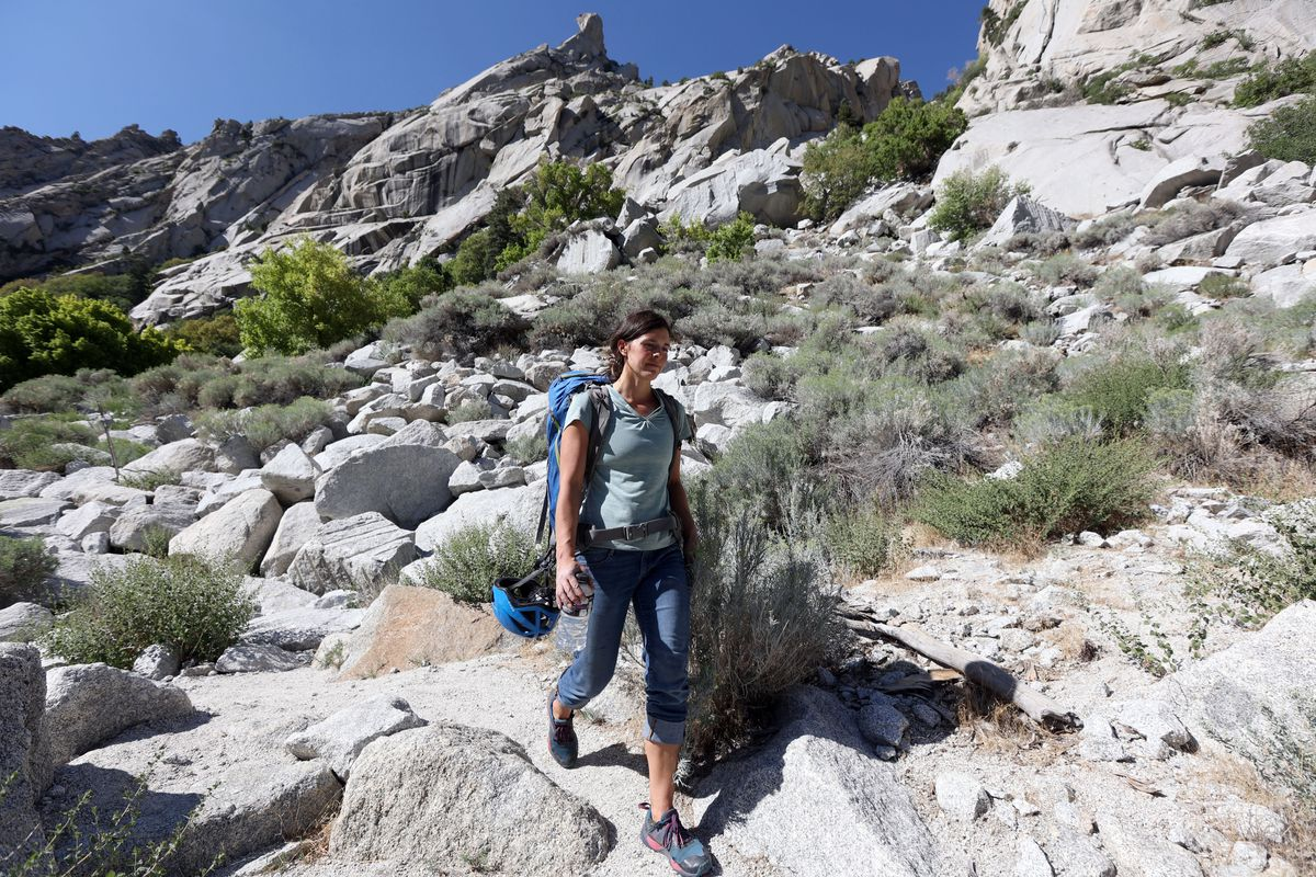 Sarah Schenk hikes down to the Gate Buttress parking lot after climbing After the Fall and Gordon's Hangover in Little Cottonwood Canyon on Monday, Aug. 23, 2021.