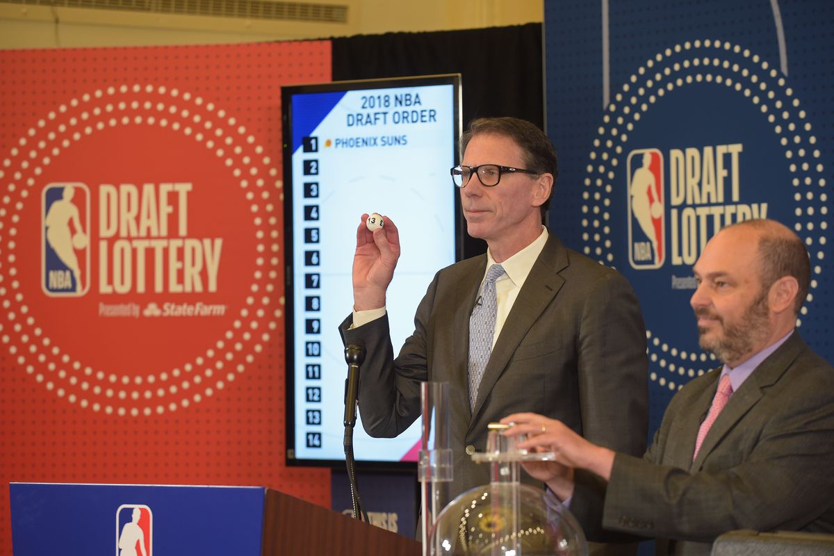 Kiki VanDeWeghe, Executive Vice President of Basketball Operations for the NBA, picks out a ping pong ball during the 2018 NBA Draft Lottery at the Palmer House Hotel on May 15, 2018 in Chicago Illinois.