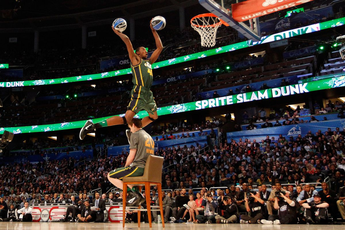 Jeremy Evans of the UTah Jazz  jumps over teammate Gordon Haywood as he dunks two basketballs during the Sprite Slam Dunk Contest.