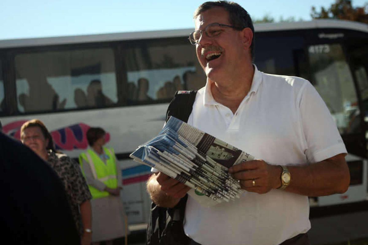 Randy Sweet, with Mormonism Research Ministry, hands out religious publications outside of the Brigham City Utah Temple in Brigham City on Friday, Sept. 14, 2012.