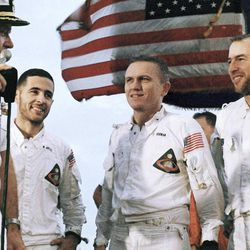 Col. Frank Borman, Apollo 8 astronaut with William Anders, center, and James A. Lovell, Jr., right, on the flight deck of the carrier U.S.S. Yorktown, recovery ship  Dec. 27, 1968.