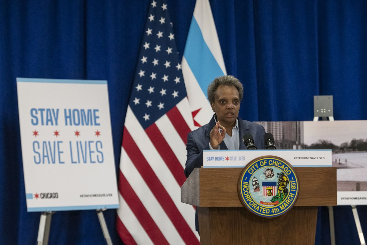 Mayor Lori Lightfoot speaks to reporters Thursday about her decision to close the Lakefront Trail, the downtown Riverwalk and other major public gathering places amid the coronavirus pandemic.