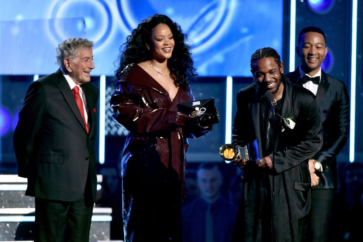 """Rihanna and Kendrick Lamar accept the Best Rap/Sung Performance award for """"Loyalty"""" from Tony Bennett and John Legend onstage during the 60th Annual Grammy Awards at Madison Square Garden on Jan. 28, 2018, in New York City."""
