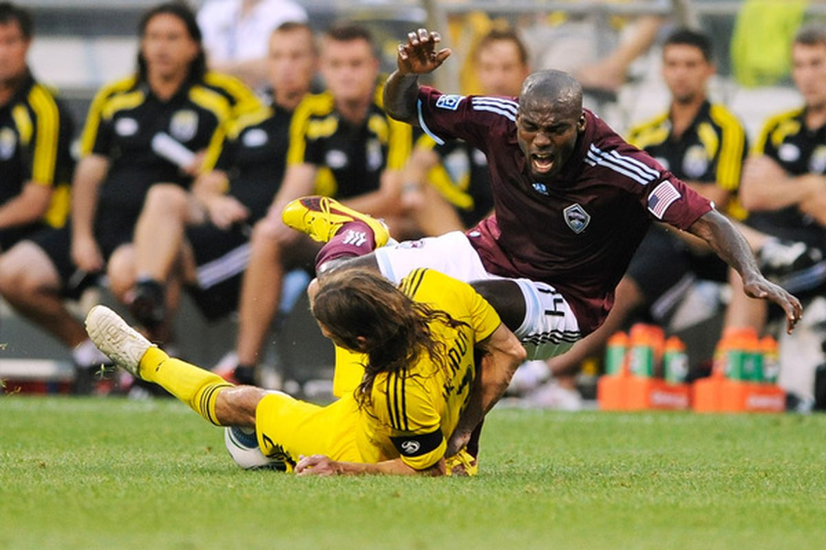 COLUMBUS OH - AUGUST 21:  Frankie Hejduk #2  of the Columbus Crew makes a tackle on Omar Cummings #14 of the Colorado Rapids on August 21 2010 at Crew Stadium in Columbus Ohio.  (Photo by Jamie Sabau/Getty Images)