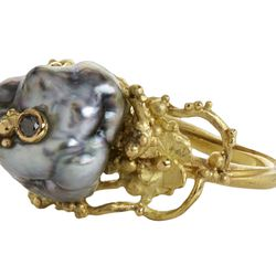 """Vibe's keshi pearl ring, <a href=""""https://www.loveadorned.com/contemporary-jewelry/vibe-s-18k-yellow-gold-ring-with-large-grey-keshi-pearl-flowers-and-05ct-grey-diamond-accent-size-6"""">$4,890</a> at Love Adorned"""