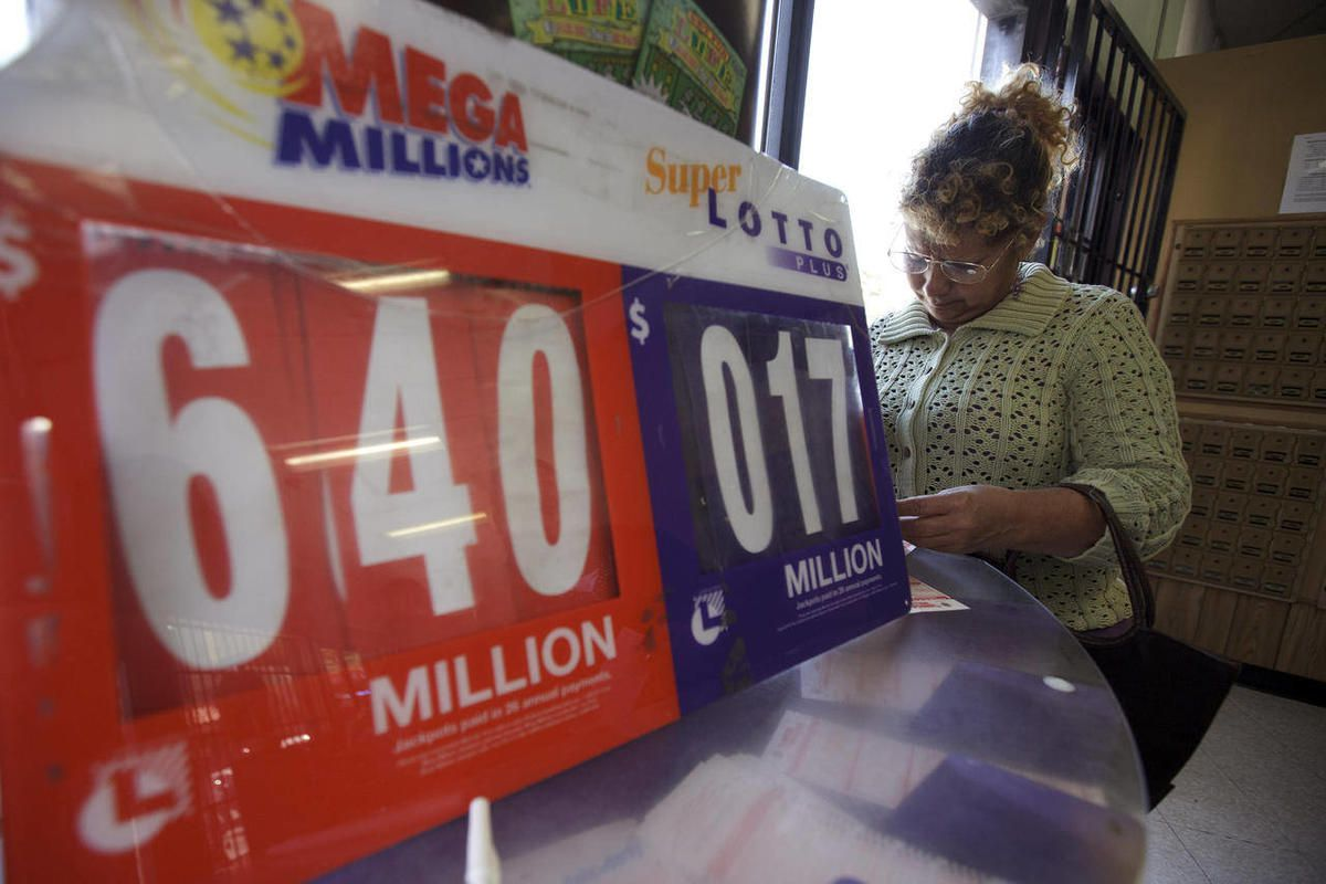 Maria Fernandez, of Tijuana, Mexico, fills out a lottery ticket for her chance to win the $640 Mega Millions jackpot near the port of entry between Tijuana and San Diego Friday, March 30, 2012, in San Diego. Many Mexicans from the border city of Tijuana j