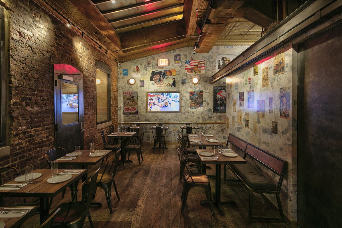 The interior of a restaurant that features walls plastered with newspaper clippings and old movie posters