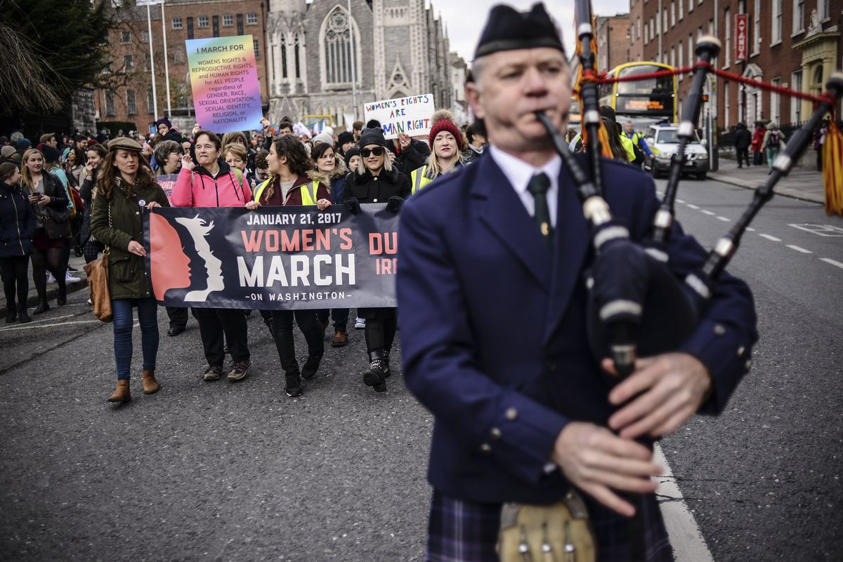 A man plays the bagpipes during a protest held in solidarity with the Washington DC Women's March in Dublin, Ireland on January 21, 2017.