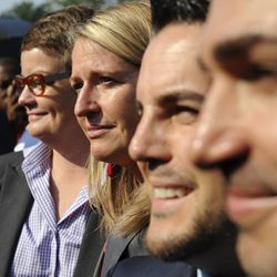 California's Proposition 8 plaintiffs, from left, Kris Perry, Sandy Steir, Jeff Zarrillo, and Paul Katami walk into the Supreme Court in Washington, Wednesday, June 26, 2013. The Supreme Court is meeting to deliver opinions in two cases that could dramatically alter the rights of gay people across the United States. The justices are expected to decide their first-ever cases about gay marriage Wednesday in their last session before the court's summer break. Hours before the court was to issue its rulings, crowds began lining up outside the Supreme Court building in hopes of getting a seat inside the courtroom.   (AP Photo/Cliff Owen)