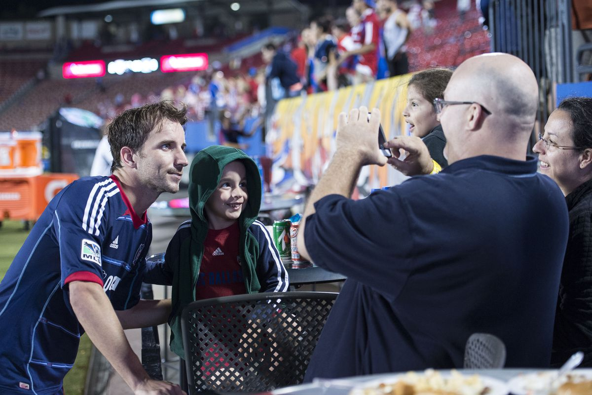 Such is the life of the presumptive MVP: Magee poses for a shot with an FC Dallas fan after the Fire's 3-2 road win in Frisco.