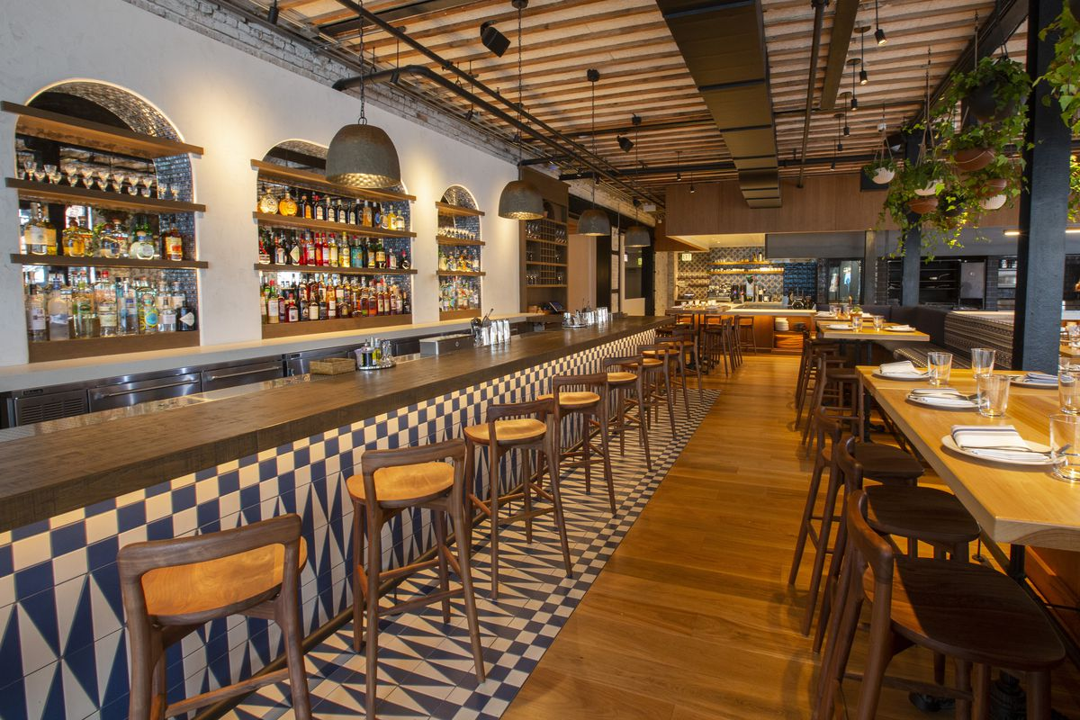 A long, bright bar and restaurant space