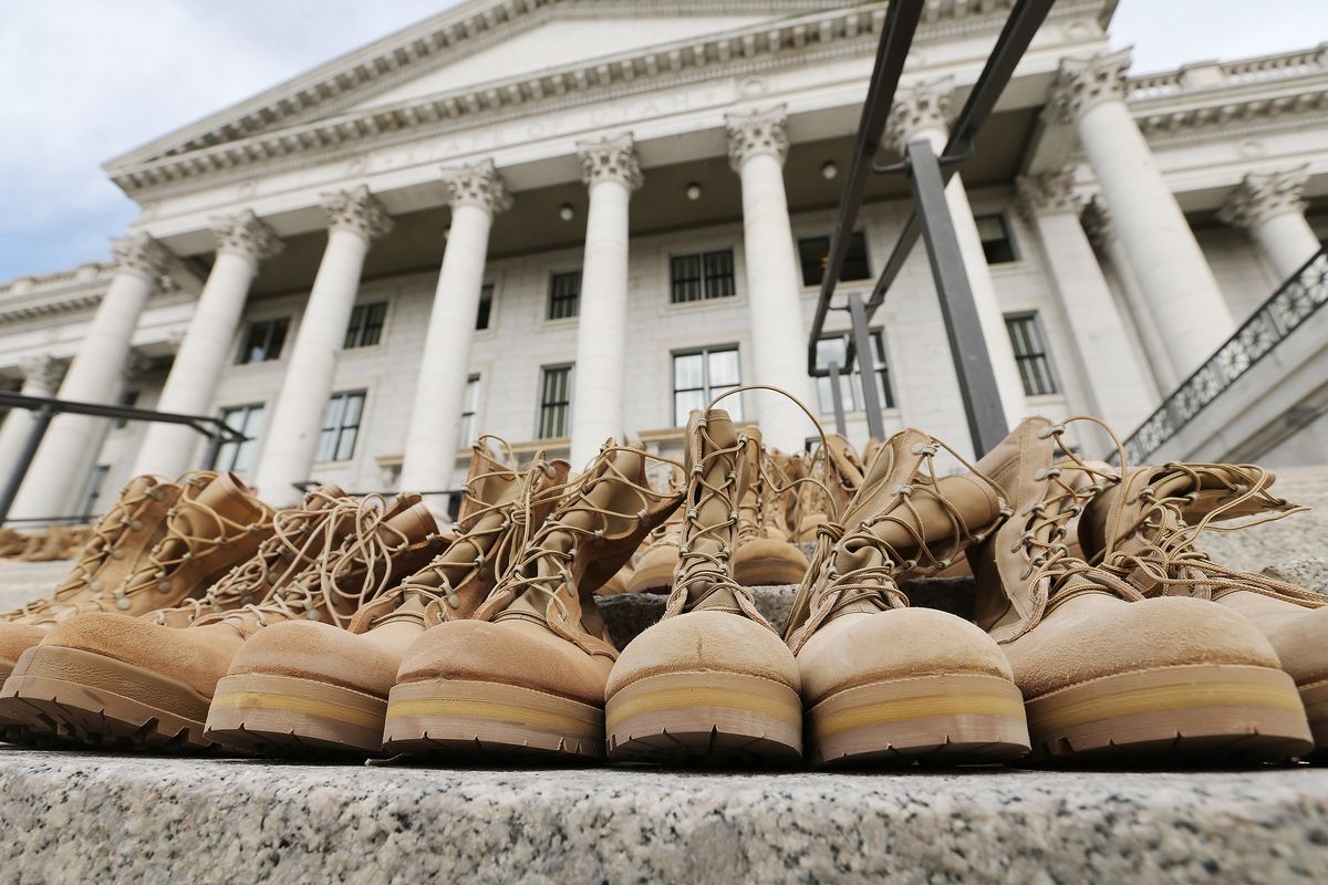 The steps to the Capitol in Salt Lake City are filled with 613 pairs of boots and shoes before a press conference with Rep. Steve Eliason, R-Sandy, and the Utah Chapter of the American Foundation for Suicide Prevention on Tuesday, Feb. 21, 2017. The display consisted of combat boots from the National Guard and shoes from Deseret Industries. Each pair represented the 613 military and civilian lives lost to suicide in Utah last year.
