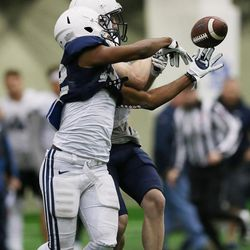 Brigham Young Cougars DB Matthew Treanor (39) breaks up the pass for Brigham Young Cougars wide receiver Tariq Buchanan (82) during an intersquad scrimmage in Provo on Friday, March 23, 2018.