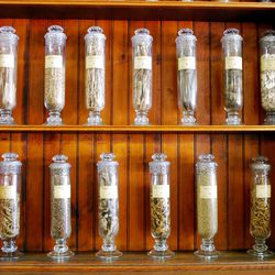 Shelves and display cases abound with medicines and herbs of the past, filling glass jars and tin canisters just across the room from another common remedy for whatever ails you -- Pioneer Village's popular ice cream shop.