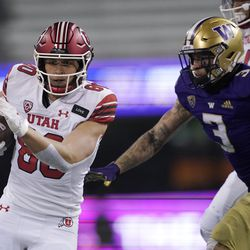 Utah tight end Brant Kuithe, left, runs the ball as Washington defensive back Elijah Molden (3) closes in during the first half of an NCAA college football game Saturday, Nov. 28, 2020, in Seattle.