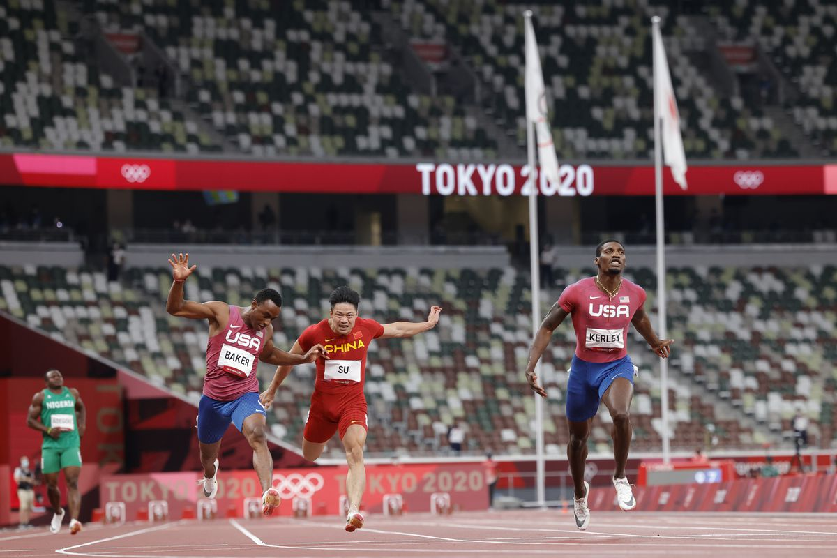 Fred Kerley of USA racing with Su Bingtian of China and Ronnie Baker of USA at the the 2020 Tokyo Summer Olympic Games in Tokyo, Japan.