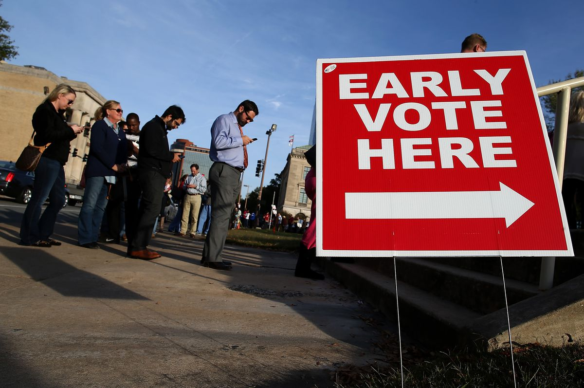 People line up for early voting outside of the Pulaski County Regional Building on November 3, 2014 in Little Rock, Arkansas.