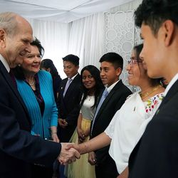 President Russell M. Nelson of The Church of Jesus Christ of Latter-day Saints and his wife Sister Wendy Nelson greet Rubi Tituana before a Latin America Ministry Tour devotional in Quito, Ecuador on Monday, Aug. 26, 2019.