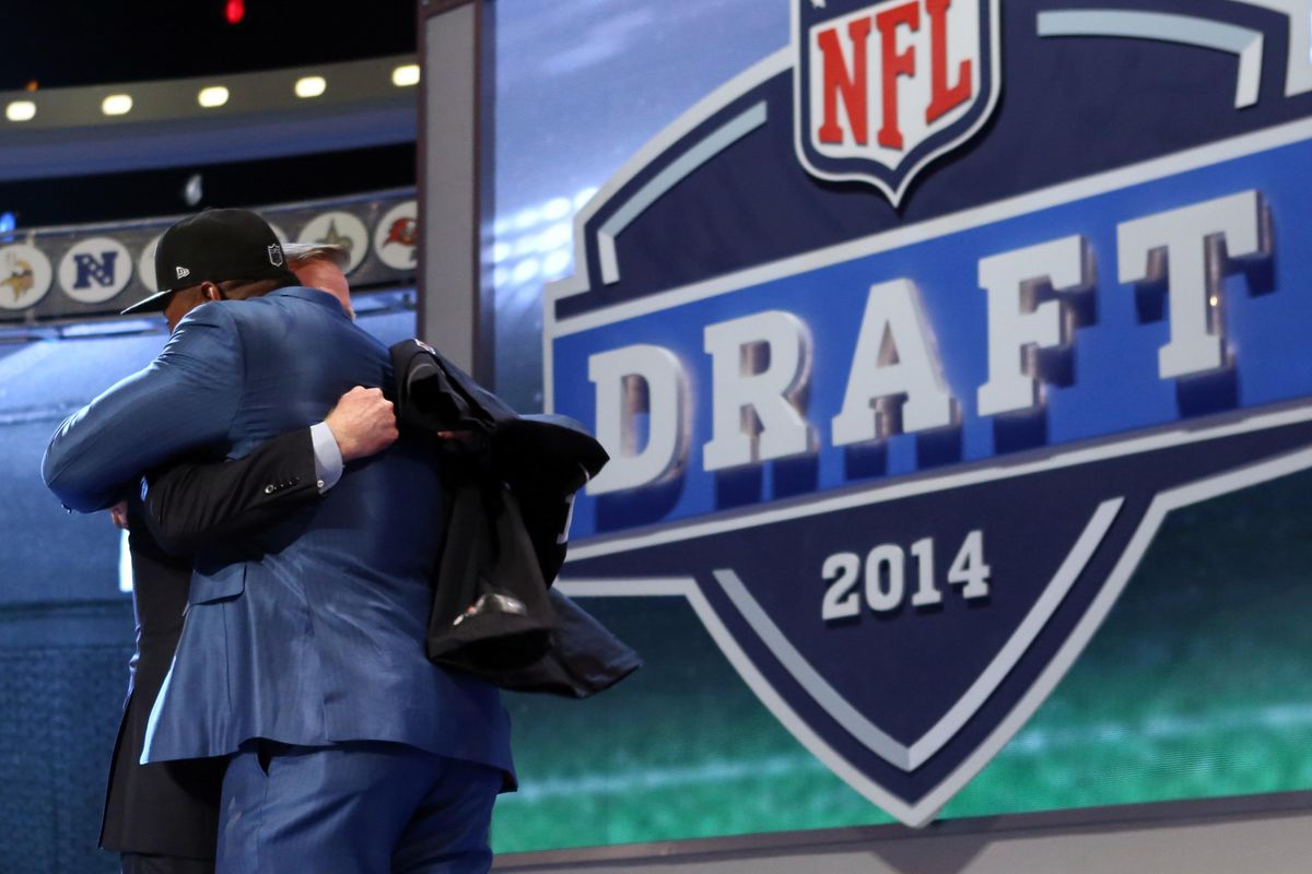 Isn't that what the Draft is all about?  Multimillionaires hugging on a stage in front of millions?