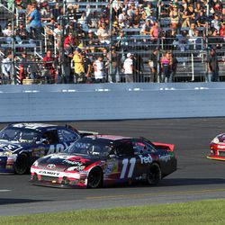 Denny Hamlin (11) competes with Jimmie Johnson during the final restart in the NASCAR Sprint Cup Series auto race at New Hampshire Motor Speedway, Sunday, Sept. 23, 2012, in Loudon, N.H. Hamlin won the race, and Johnson finished second.