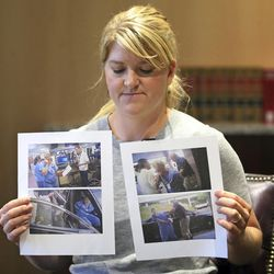 In this Friday, Sept. 1, 2017, photo, nurse Alex Wubbels displays video frame grabs from SaltLake City Police Department body cams of herself being taken into custody, during an interview, in Salt Lake City. Officials at University of Utah Hospital, where Wubbels was arrested after refusing to allow police to draw a patient's blood, are apologizing that security officers didn't intervene and saying they've implemented policy changes.