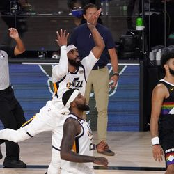 Utah Jazz's Mike Conley, middle center, Royce O'Neale, bottom center, Jazz head coach Quin Snyder, center rear, and Denver Nuggets' Jamal Murray, right, watch as Conley's shot rims out in the closing seconds of their NBA first round playoff basketball game, Tuesday, Sept. 1, 2020, in Lake Buena Vista, Fla.