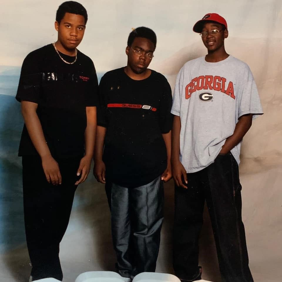 Thomas Fields, far right, is shown during his middle school days at Malcolm X Academy, which later merged with Paul Robeson Academy. Fields was the school culture facilitator at the combined school when he died March 30.
