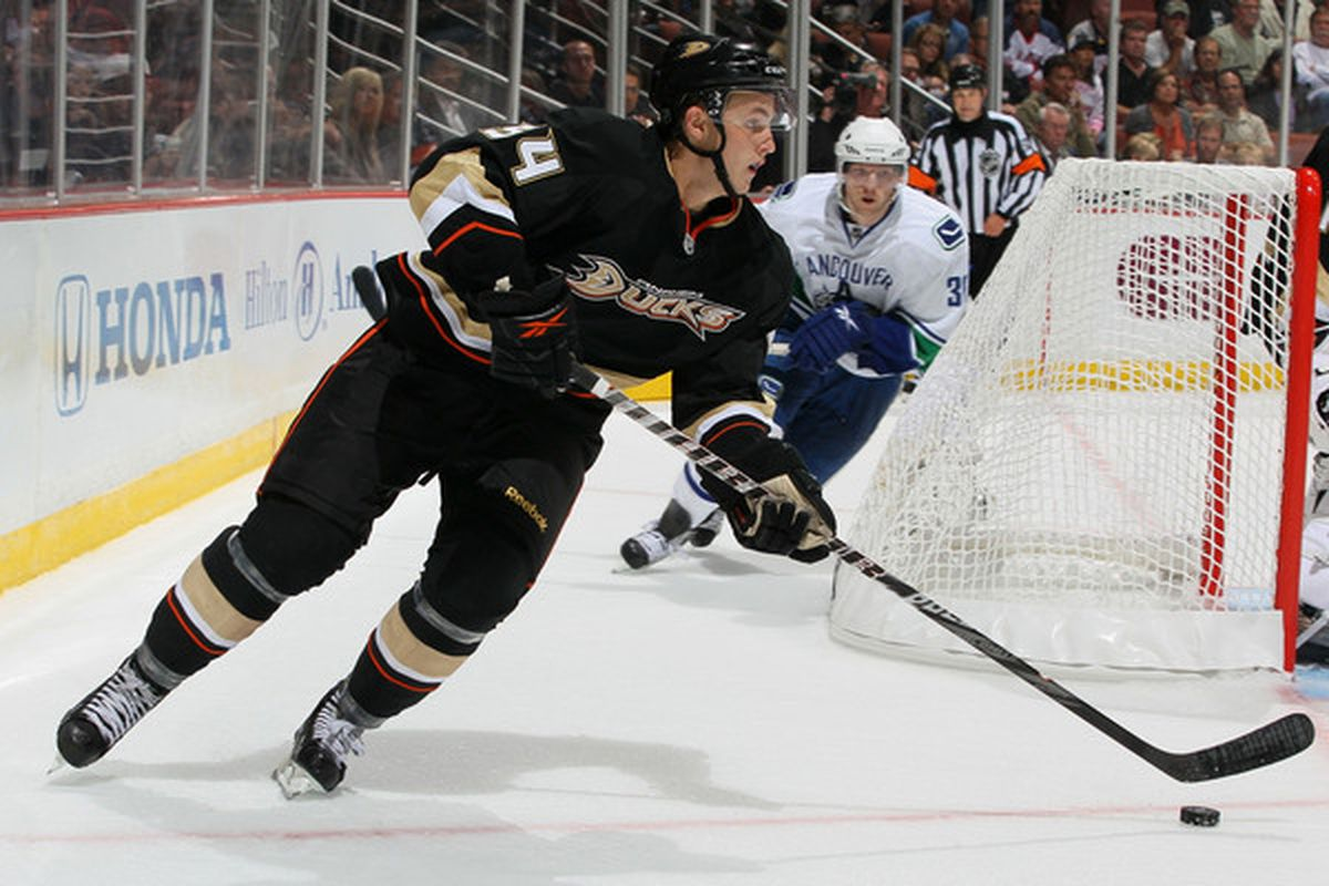 ANAHEIM CA - OCTOBER 13:  Cam Fowler #54 of the Anaheim Ducks skates with the puck against the Vancouver Canucks during their game at Honda Center on October 13 2010 in Anaheim California.  (Photo by Jeff Gross/Getty Images)