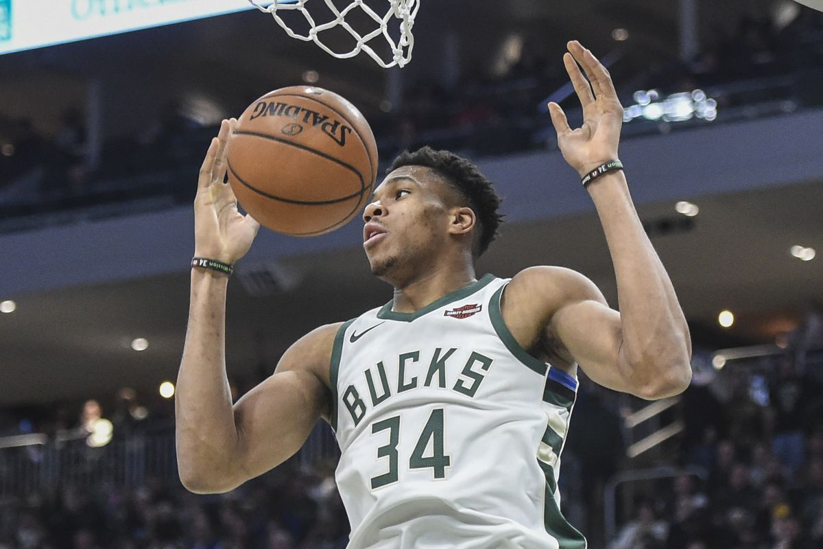 Milwaukee Bucks forward Giannis Antetokounmpo dunks a basket in the fourth quarter during the game against the Cleveland Cavaliers at Fiserv Forum.