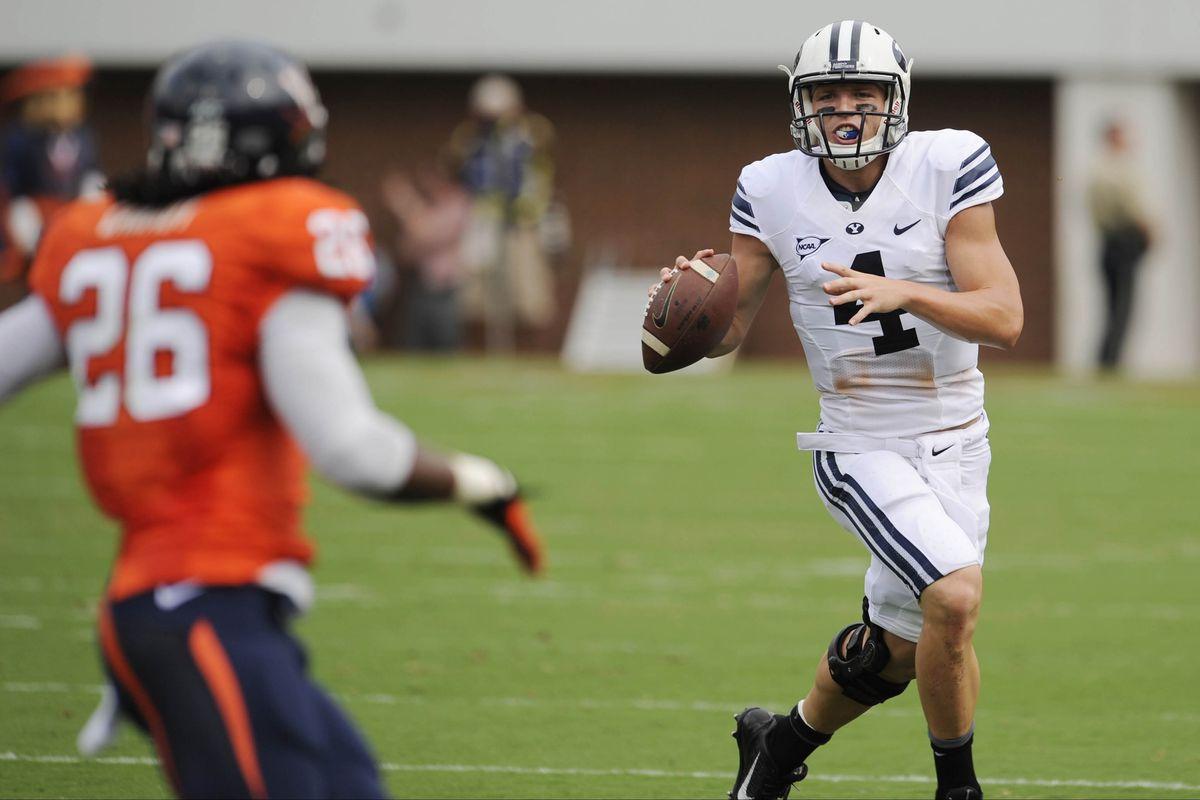 Taysom Hill looks down field against Virginia