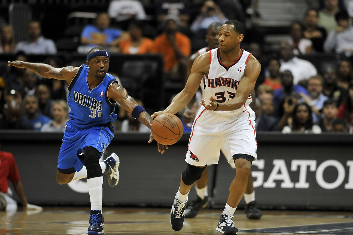 Apr 26, 2012; Atlanta, GA, USA; Dallas Mavericks shooting guard Jason Terry (31) and Atlanta Hawks shooting guard Willie Green (33) fight for a loose ball during the first half at Philips Arena. Mandatory Credit: Paul Abell-US PRESSWIRE