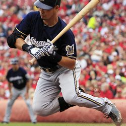 Milwaukee Brewers' Norichika Aoki, from Japan, jumps to avoid a low pitch in the third inning of a baseball game against the Cincinnati Reds, Thursday, Sept. 27, 2012, in Cincinnati.