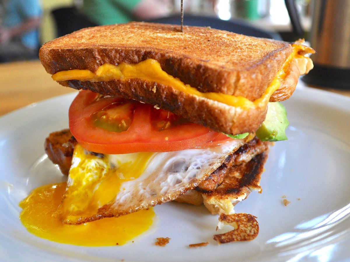 Eggs, chorizo, tomato, avocado, and Boursin stuffed between two grilled cheese sandwiches