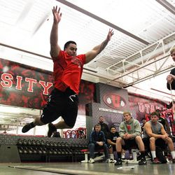 Star Lotulelei does a standing long jump during Utah Pro Day at the University of Utah in Salt Lake City, Wednesday, March 20, 2013. For roughly 20 years, Utah has emphasized its ability to recruit polynesian players.