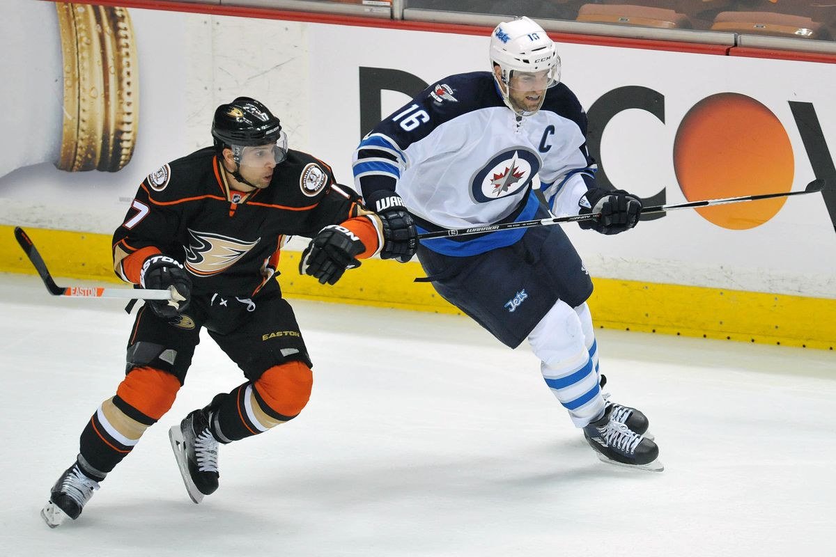 Andrew Ladd battles with Andrew Cogliano in the 2015 Stanley Cup Playoffs first round.