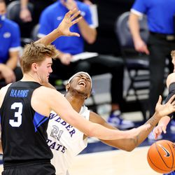 Brigham Young Cougars forward Matt Haarms (3) defends Weber State Wildcats center Dontay Bassett (21) as BYU and Weber State play an NCAA basketball game at Vivint Smart Home Arena in Salt Lake City on Wednesday, Dec. 23, 2020.