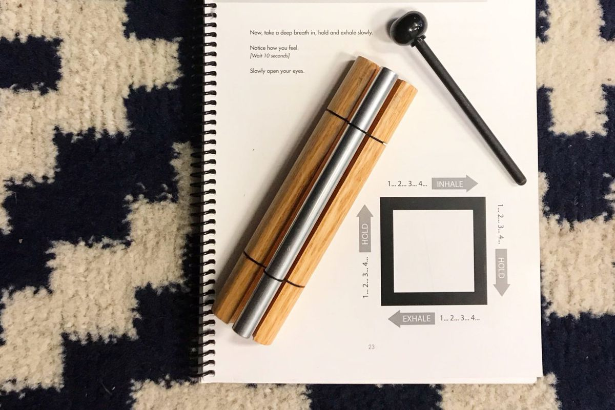 Calm Classroom accessories including wood chimes and a curriculum guide