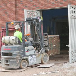 2:36 p.m. Bricks being moved inside an open gate on the right-field side -